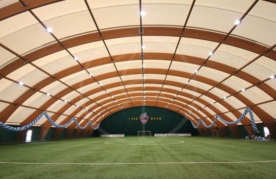 Structure en bois lamellé terrain de football