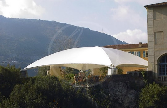 Tensile structure with crossed arches