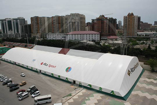 Tenso-structure en bois lamellé 100x30 + 42x22 mètres
